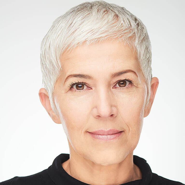 Woman with short white hair